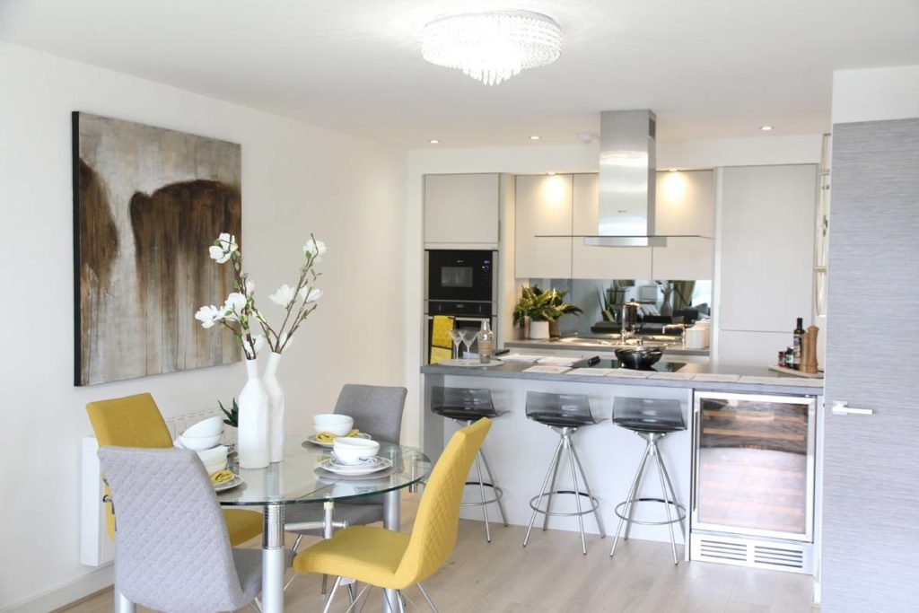 Dining area in Broadway Development apartment by MH Stainton Homes