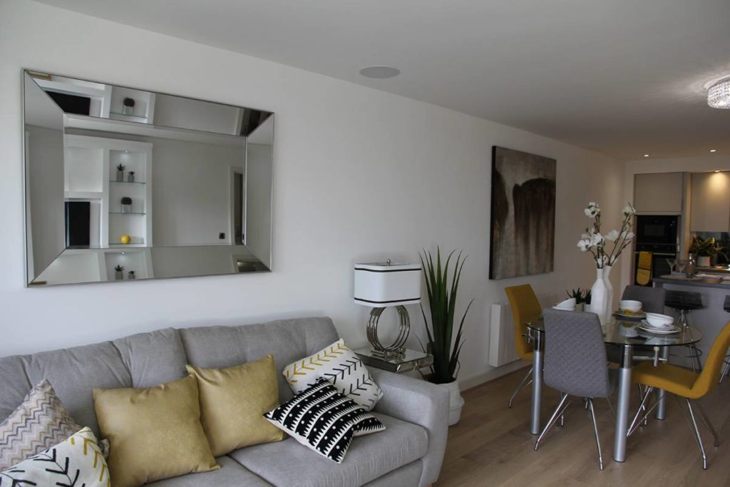 Living room in Broadway Development apartment by MH Stainton Homes